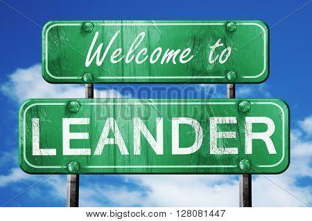 leander vintage green road sign with blue sky background