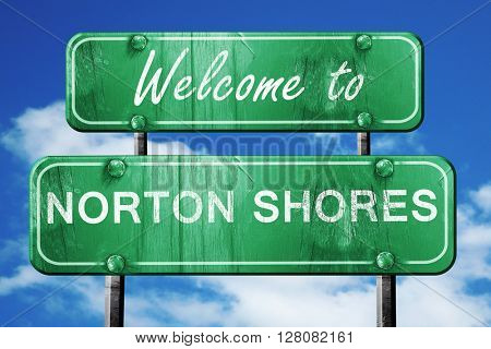norton shores vintage green road sign with blue sky background