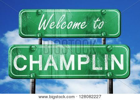 champlin vintage green road sign with blue sky background