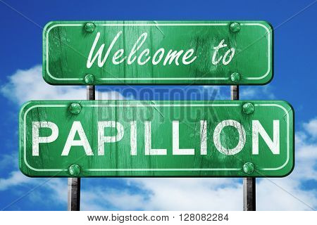 papillion vintage green road sign with blue sky background