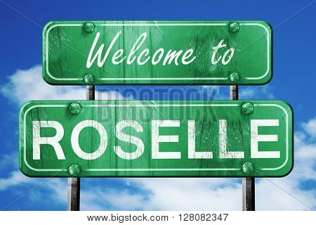 roselle vintage green road sign with blue sky background