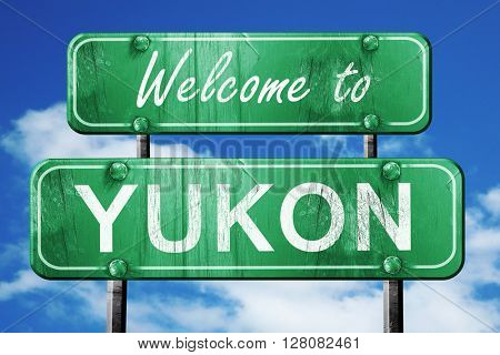 yukon vintage green road sign with blue sky background