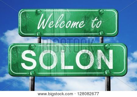 solon vintage green road sign with blue sky background