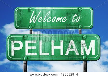 pelham vintage green road sign with blue sky background