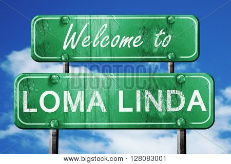 loma linda vintage green road sign with blue sky background