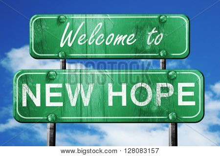 new hope vintage green road sign with blue sky background