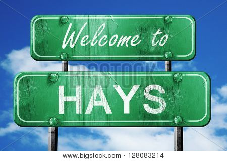 hays vintage green road sign with blue sky background