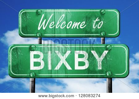 bixby vintage green road sign with blue sky background