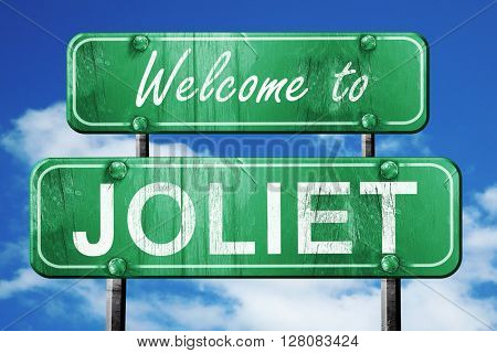 joliet vintage green road sign with blue sky background
