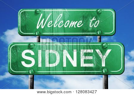 sidney vintage green road sign with blue sky background
