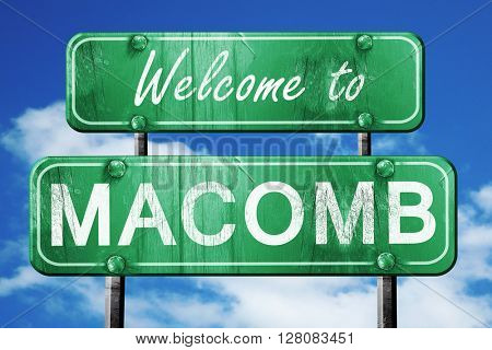 macomb vintage green road sign with blue sky background