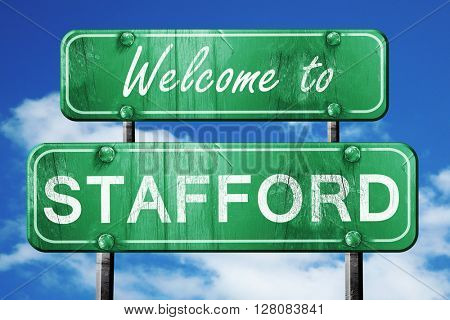 stafford vintage green road sign with blue sky background