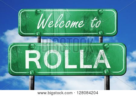 rolla vintage green road sign with blue sky background