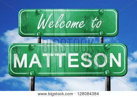 matteson vintage green road sign with blue sky background