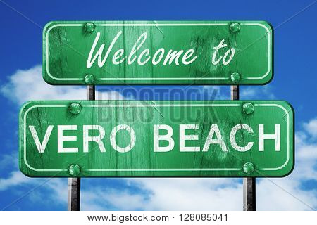 vero beach vintage green road sign with blue sky background