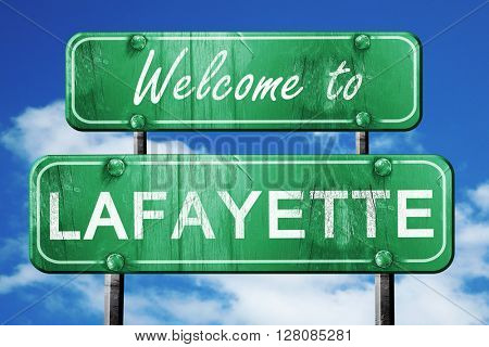 lafayette vintage green road sign with blue sky background
