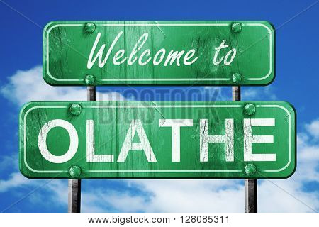olathe vintage green road sign with blue sky background