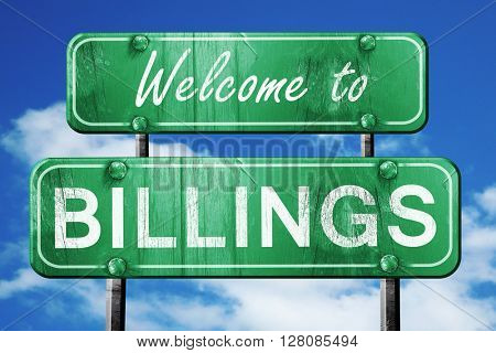 billings vintage green road sign with blue sky background