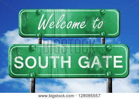 south gate vintage green road sign with blue sky background