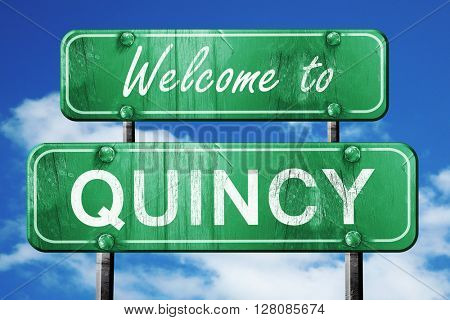 quincy vintage green road sign with blue sky background
