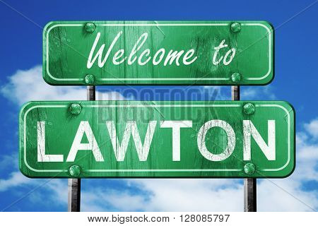 lawton vintage green road sign with blue sky background