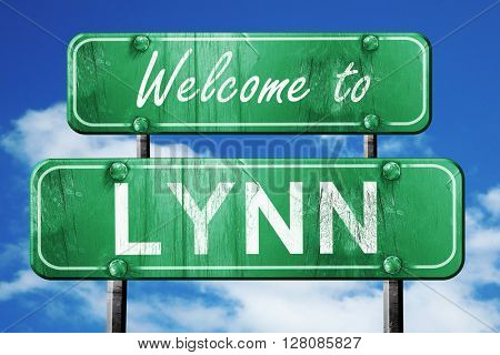 lynn vintage green road sign with blue sky background