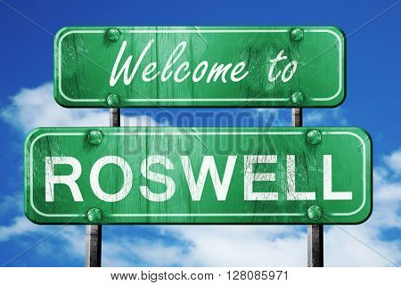 roswell vintage green road sign with blue sky background