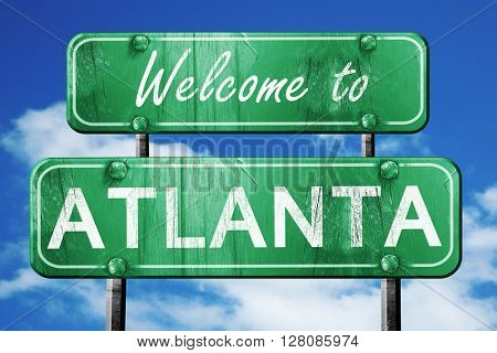 atlanta vintage green road sign with blue sky background