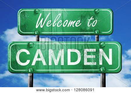 camden vintage green road sign with blue sky background