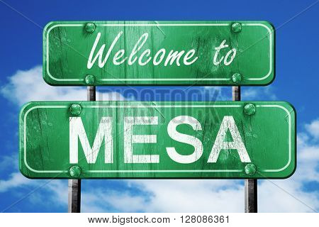 mesa vintage green road sign with blue sky background