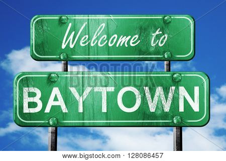 baytown vintage green road sign with blue sky background