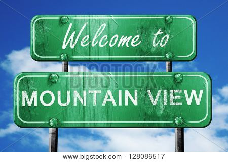 mountain view vintage green road sign with blue sky background