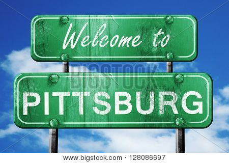 pittsburg vintage green road sign with blue sky background