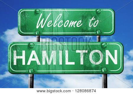 hamilton vintage green road sign with blue sky background