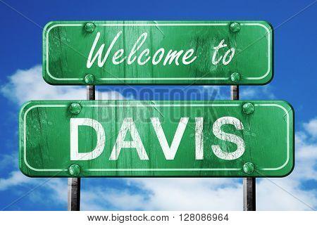 davis vintage green road sign with blue sky background