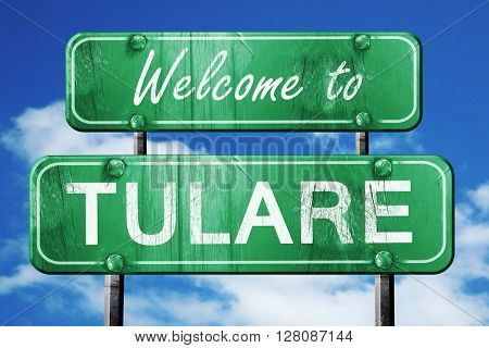 tulare vintage green road sign with blue sky background