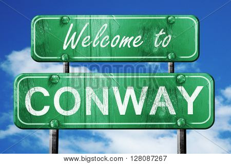 conway vintage green road sign with blue sky background