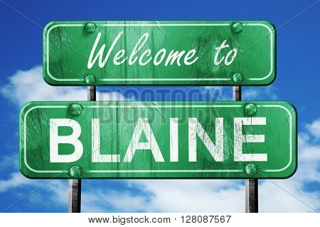 blaine vintage green road sign with blue sky background