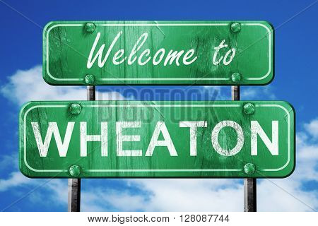 wheaton vintage green road sign with blue sky background