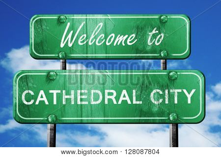 cathedral city vintage green road sign with blue sky background