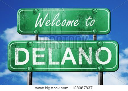 delano vintage green road sign with blue sky background