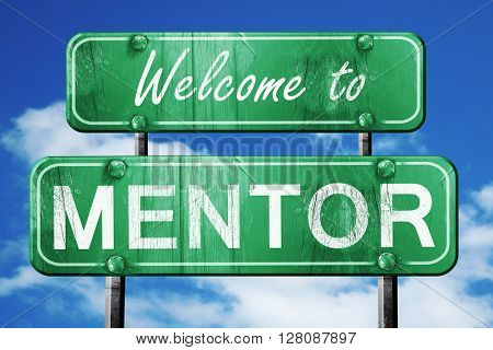 mentor vintage green road sign with blue sky background