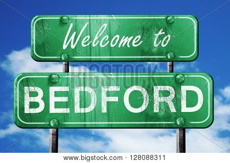 bedford vintage green road sign with blue sky background