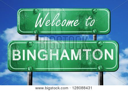 binghamton vintage green road sign with blue sky background