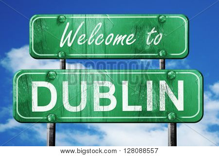 dublin vintage green road sign with blue sky background