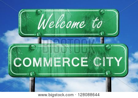 commerce city vintage green road sign with blue sky background
