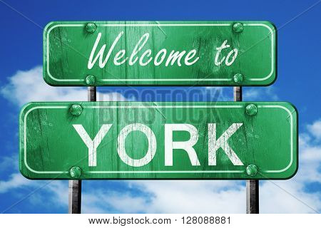 york vintage green road sign with blue sky background