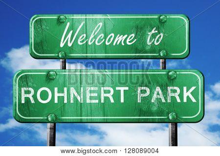 rohnert park vintage green road sign with blue sky background