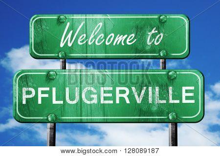 pflugerville vintage green road sign with blue sky background