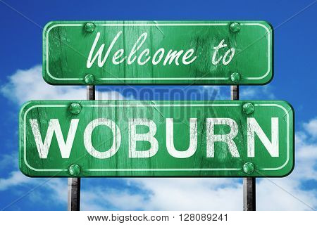 woburn vintage green road sign with blue sky background